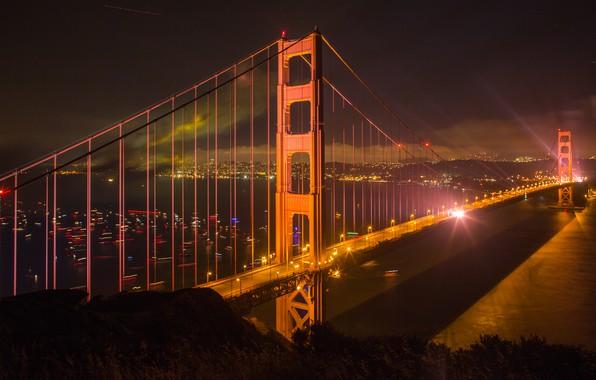 Картинка ночь, мост, город, огни, река, Сан-Франциско, США, мегаполис, берега, ночное небо, плавсредства
