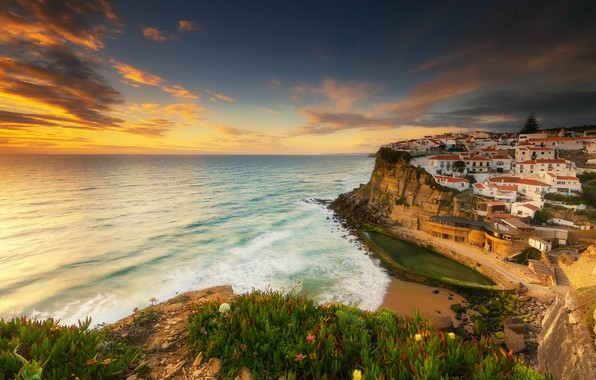 Картинка море, небо, солнце, облака, закат, камни, скалы, побережье, дома, горизонт, Португалия, Синтра