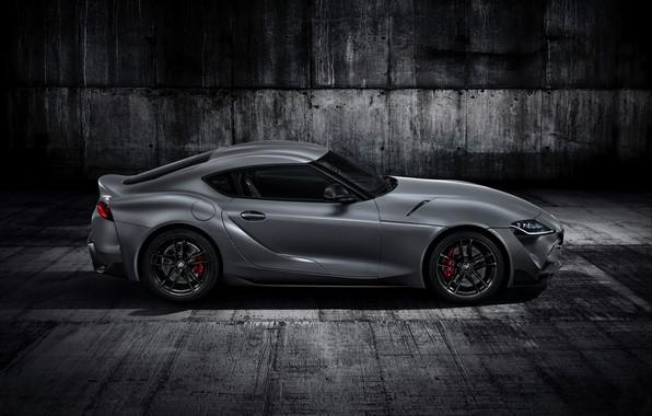 Картинка серый, фон, купе, Toyota, вид сбоку, тёмный, Supra, пятое поколение, mk5, двухместное, 2019, GR Supra, …