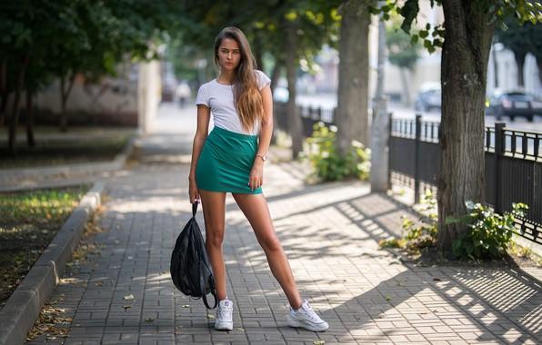 Картинка girl, legs, trees, photo, photographer, blue eyes, model, bokeh, brunette, urban, t-shirt, skirt, portrait, sneakers, …