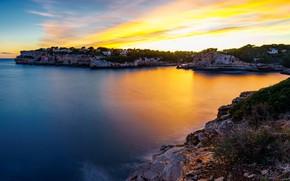 Картинка море, небо, деревья, закат, камни, скалы, побережье, дома, горизонт, залив, Испания, Майорка, Мальорка, Mirador Es …