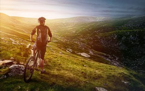 Картинка трава, пейзаж, горы, велосипед, камни, шорты, склон, очки, куртка, перчатки, шлем, велосипедист, кроссовки