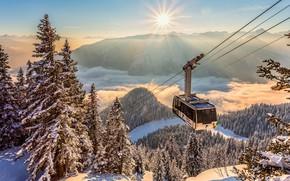 Картинка зима, солнце, облака, лучи, снег, пейзаж, горы, природа, ели, Альпы, вагончик, леса, кабинка, канатная дорога, …