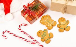 Картинка праздник, шапка, новый год, печенье, подарки, леденцы, шишка, колпак, ленточки, коробки, печеньки