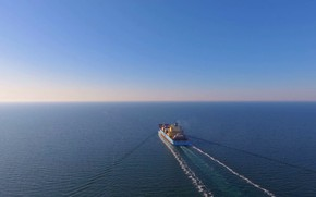 Картинка aerial view, after loading, container ship, floats in the open ocean