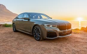 Картинка car, машина, небо, вода, закат, горы, фары, BMW, седан, колёса, xDrie, 745Le, green car, BMW …