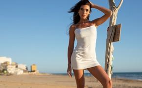Картинка beach, sign, sand, bokeh, blue sky, buildings, outside, sexy woman, posing, white dress, beautiful face, …
