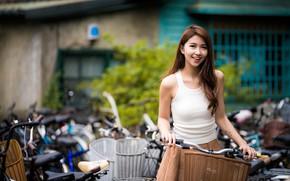 Картинка взгляд, поза, модель, юбка, портрет, макияж, майка, прическа, шатенка, азиатка, стоит, велосипеды, боке, улыбается