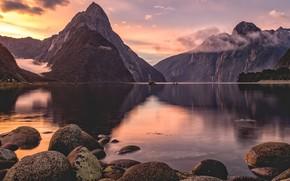 Картинка облака, пейзаж, закат, горы, природа, озеро, отражение, камни, скалы, рассвет, берег, водоем, водная гладь, валуны, …