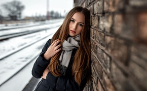 Картинка girl, wall, long hair, photo, photographer, bricks, blue eyes, snow, model, lips, face, coat, brunette, …