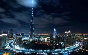 Картинка небо, облака, свет, ночь, город, огни, темнота, вид, здания, башня, дома, круг, небоскребы, Дубай, архитектура, …