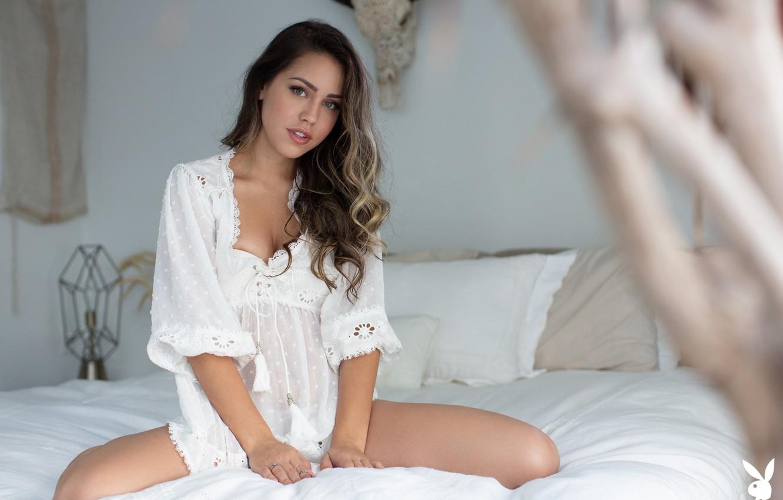 Фото обои girl, Playboy, playmate, legs, photo, blue eyes, model, bokeh, brunette, bed, sitting, shirt, portrait, in …