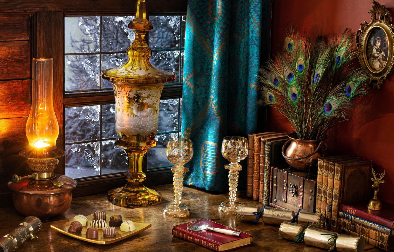 Фото обои стол, книги, лампа, перья, бокалы, окно, конфеты, свитки, портьеры