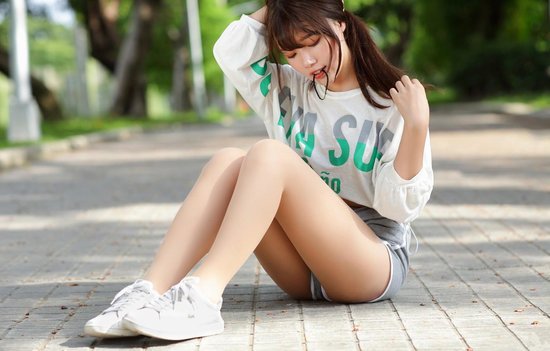 Фото обои girl, Model, shorts, legs, brunette, asian, t-shirt, sitting, sneakers, bangs, closed eyes, short shorts, parted …
