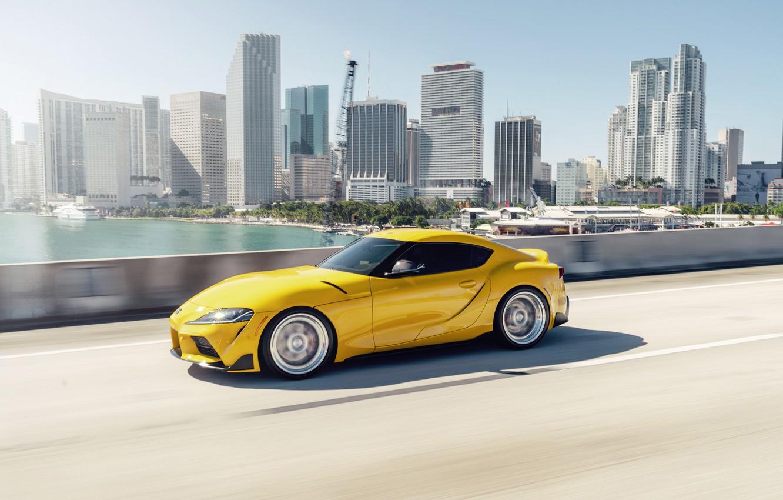 Фото обои дорога, жёлтый, спорткар, Toyota Supra, дания, 2020 Toyota GR Supra