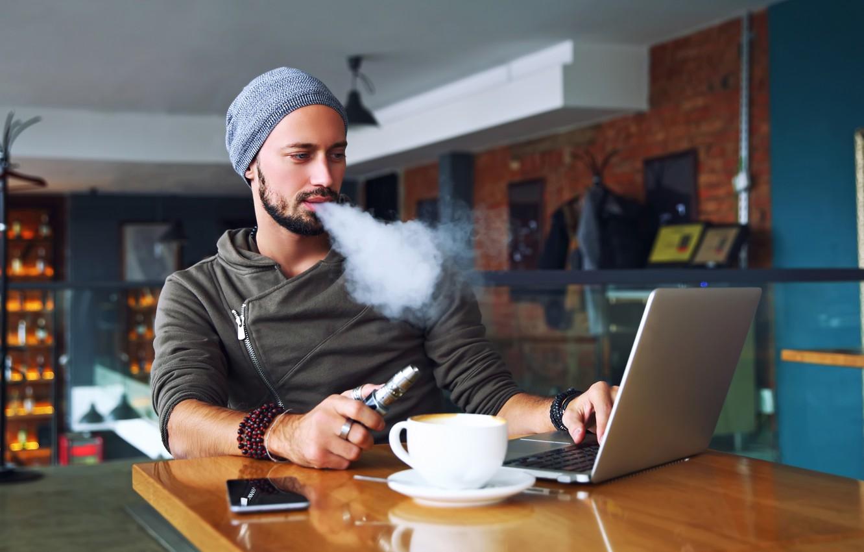 Фото обои smoke, notebook, man, wool hat, cell phone, electronic cigarette