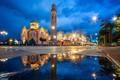 Картинка дорога, небо, облака, деревья, ночь, огни, часы, башня, дома, фонари, церковь, лужи, храм, архитектура, Босния ...